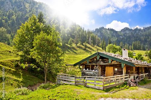 Obraz na płótnie Wooden hut in the mountains
