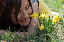 Young Woman Smelling Daffodils