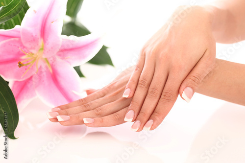 Staande foto Manicure Beautiful woman hands and lily flower