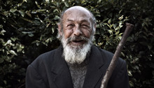 Portrait Of An Elderly Bearded Man With A Smile On Face