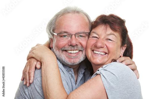 Fototapety, obrazy: Glückliche Senioren umarmen sich