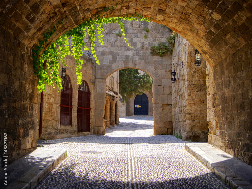 Fototapeta Medieval arched street in the old town of Rhodes, Greece