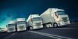 Leinwandbild Motiv Eine Gruppe LKW fährt schnell auf einer Straße