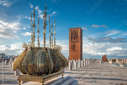 Photo Stands Morocco Tour Hassan tower golden decorations Rabat Morocco