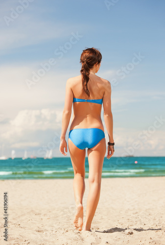 Fotobehang womenART woman on the beach