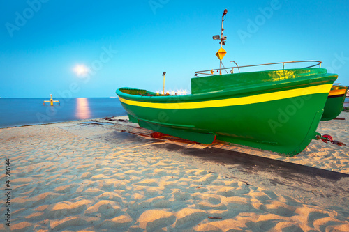 Green fishing boat on the beach of Baltic sea, Poland - 43916144