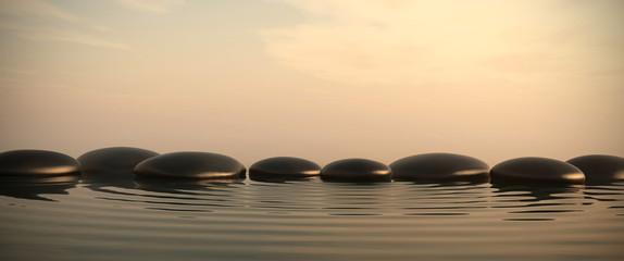 FototapetaZen stones in water on sunrise