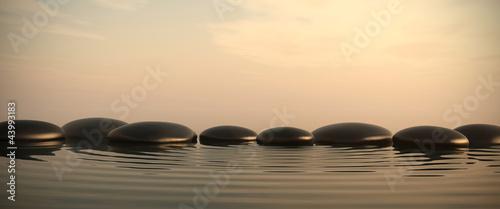 Fotobehang Zen Zen stones in water on sunrise
