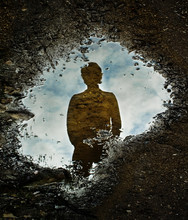 Through The Looking Glass, Reflection On A Water Puddle