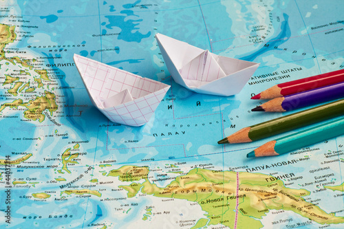 paper ships on the geography map Wallpaper Mural