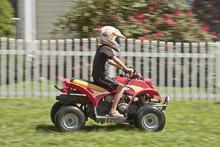 Boy Riding Four Wheeler
