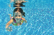 Happy underwater child in swimming pool, summer vacation, sport