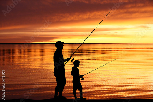 Tuinposter Vissen Fisherman silhouettes at sunrise