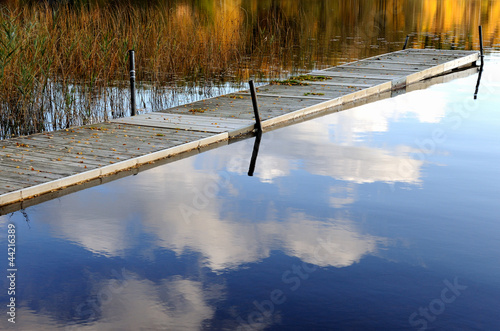 Tuinposter Pier Jetty in a Swedish lake at autumn when bathing season is over