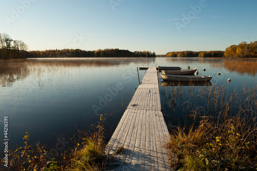 Tuinposter Pier First frost at a Swedish lake in Ostergotland