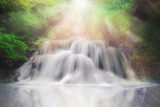 Light and waterfall in deep forest fantasy dream color