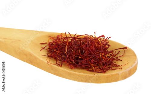 Foto op Canvas Kruiden 2 stigmas of saffron in wooden spoon on white background close-up