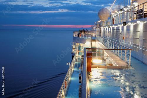 Deck of multidecked ship in evening light. Poster