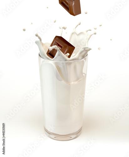 Foto op Plexiglas Milkshake Chocolate cubes splashing into a milk glass. On white background