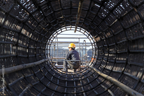 Fotografia, Obraz  reinforced component at the construction site and workers