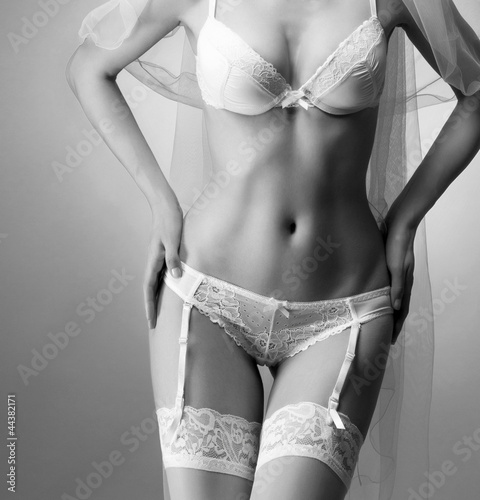 Sexy body of a young woman in erotic bridal lingerie