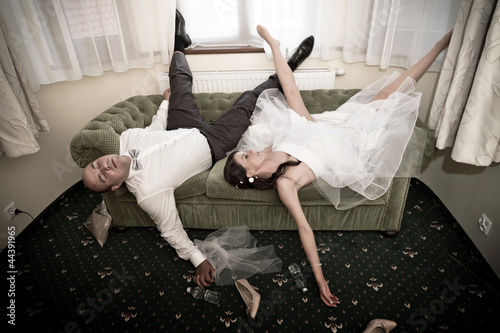 Fotografie, Obraz  Bride and groom with hangover on the sofa