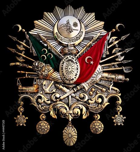 Fotografia  Turkish old Ottoman Empire emblem on black background.