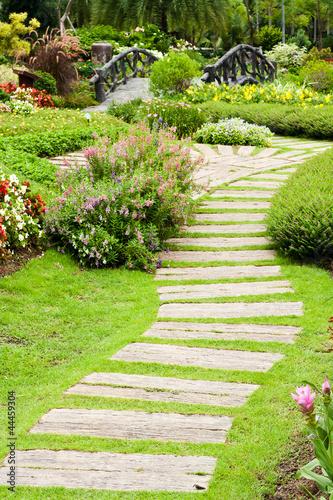 Papiers peints Jardin Landscaping in the garden. The path in the garden.