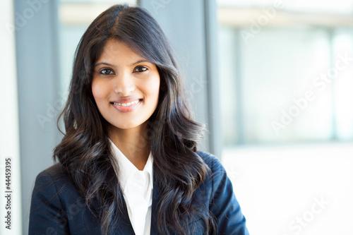 Valokuvatapetti beautiful young indian businesswoman portrait in office