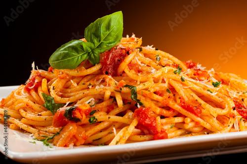 Photo sur Toile Plat cuisine Pasta with tomato sauce and parmesan