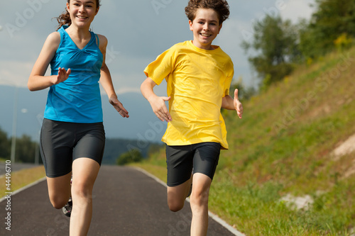 Poster Jogging Girl and boy running, jumping outdoor