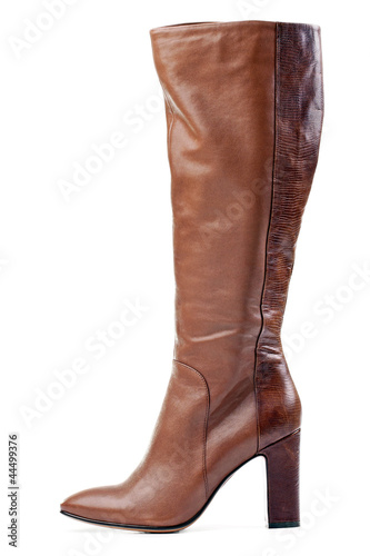 Fotografía  Brown knee high boot isolated over white