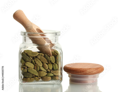 Photo Stands Herbs 2 Jar of cardamom isolated on white close-up