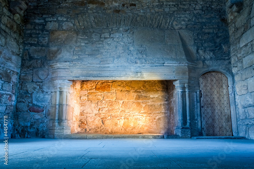Foto op Aluminium Kasteel Warm light in a cold medieval castle