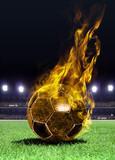 fiery soccer ball on field