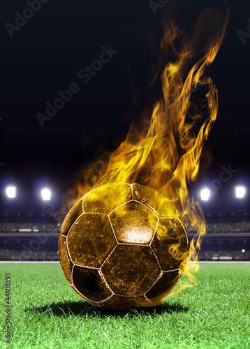 fiery soccer ball on field