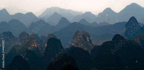 Mountain range image of Guilin at sunset. Yangshuo, China, Asia