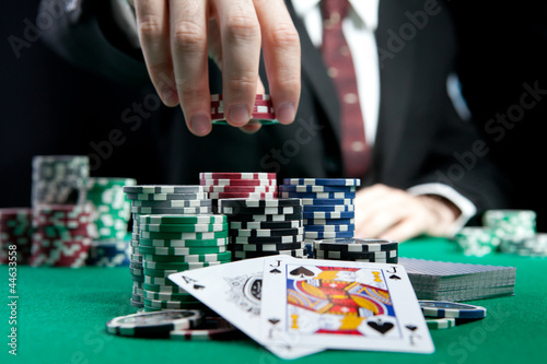 Fotografija  blackjack in a casino, a man makes a bet, and puts a chip