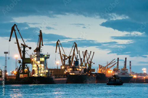 Shipyard with ships at dusk time Fototapeta