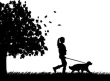 Girl Walking A Dog In Park In Autumn Or Fall