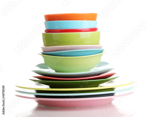 Papiers peints Plat cuisine Many colorful plates isolated on white