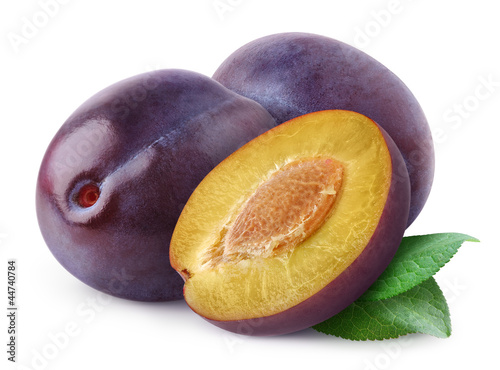 Isolated plums. Cut fresh blue plum fruits isolated on white background