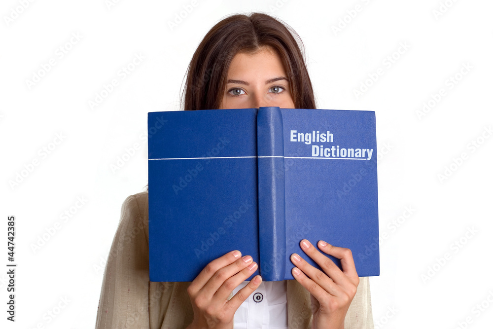 Fototapeta Student girl with English dictionary