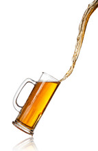 Pouring Beer Into Glass, Isolated On White Background