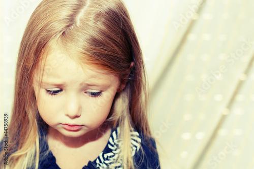 Sad little girl Wallpaper Mural