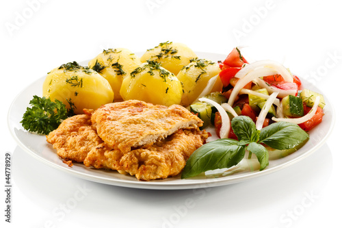 Fototapeta Pork chops, boiled potatoes and vegetable salad obraz