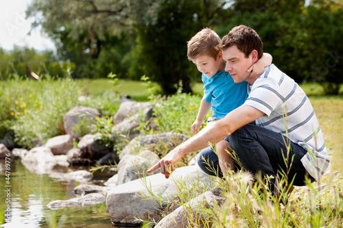 Fotografía  Fashing and Son Playing Near Lake