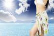 Cropped image woman in a bikini on the beach.