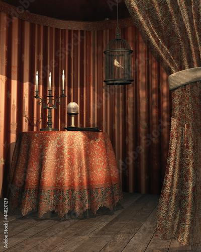 Fototapeta premium Namiot z klatką, świecą i magiczną kulą