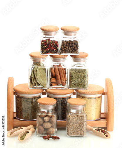 jars and wooden with spices isolated on white